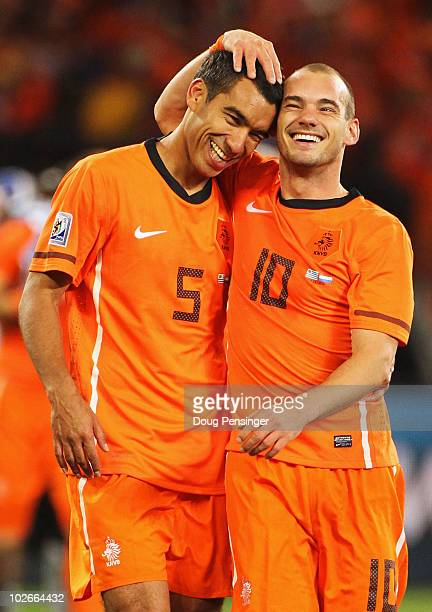 Giovanni Van Bronckhorst and Wesley Sneijder of the Netherlands celebrate victory and a place in the final during the 2010 FIFA World Cup South...