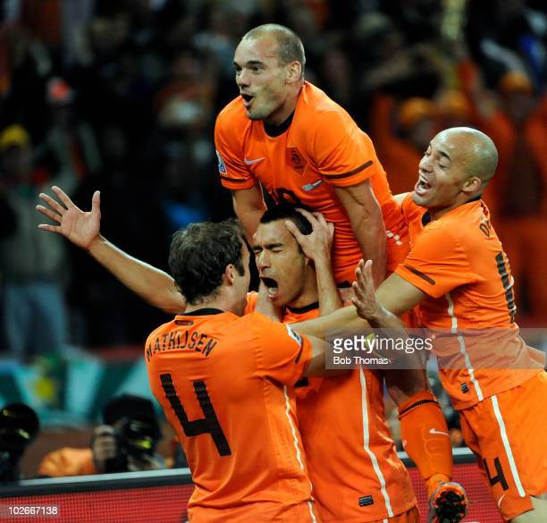 Giovanni van Bronckhorst of the Netherlands celebrates his goal with teammates Wesley Sneijder Demy de Zeeuw and Joris Mathijsen during the 2010 FIFA...