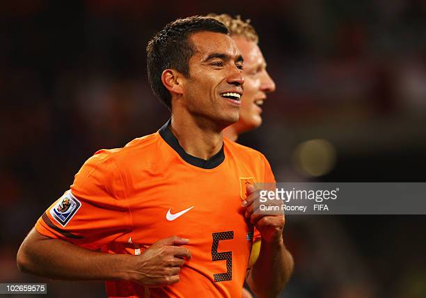 Giovanni Van Bronckhorst of the Netherlands celebrates scoring the opening goal during the 2010 FIFA World Cup South Africa Semi Final match between...
