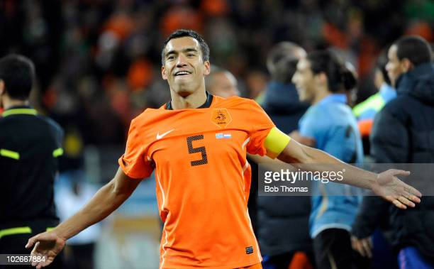 Giovanni van Bronckhorst of the Netherlands celebrates victory and progressing to the final after the 2010 FIFA World Cup South Africa Semi Final...