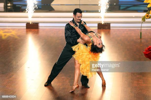 Giovanni Zarrella and Marta Arndt perform on stage during the 10th show of the tenth season of the television competition 'Let's Dance' on May 26...