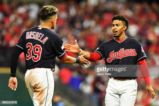 Giovanny Urshela and Francisco Lindor of the Cleveland Indians celebrate at the end of the fifth inning against the New York Yankees bin Game Five of...