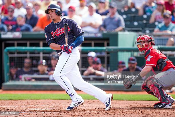 Giovanny Urshela of the Cleveland Indians bats during a spring training game against the Cincinnati Reds at Goodyear Ballpark on March 1 2016 in...