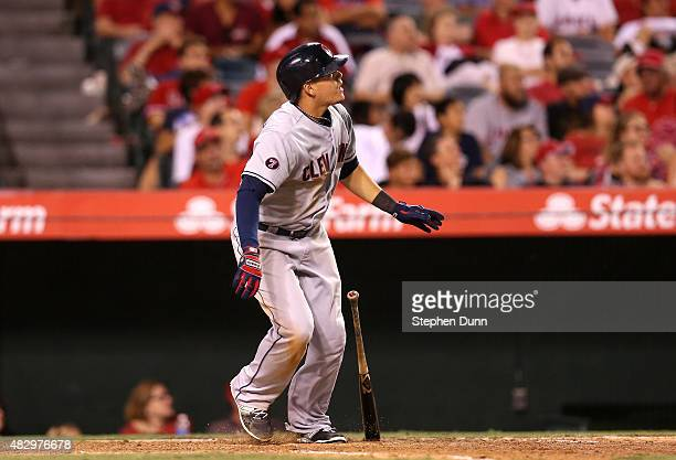 Giovanny Urshela of the Cleveland Indians drops his bat as he watches his two run home run in the 12th inning against the Los Angeles Angels of...