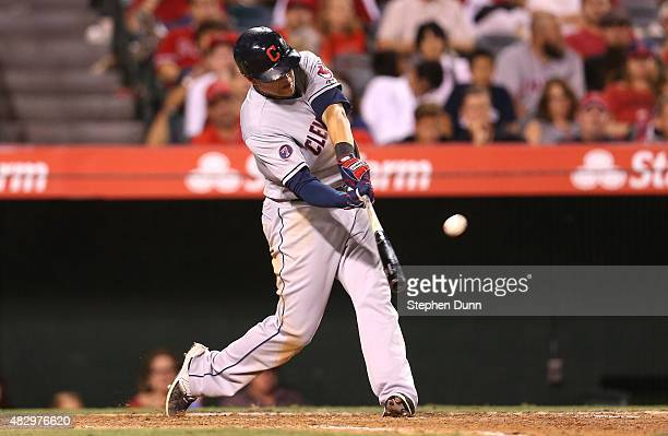 Giovanny Urshela of the Cleveland Indians hits a two run home run in the 12th inning against the Los Angeles Angels of Anaheim at Angel Stadium of...