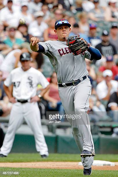 Giovanny Urshela of the Cleveland Indians throws to first base for the out against the Chicago White Sox during the seventh inning at US Cellular...