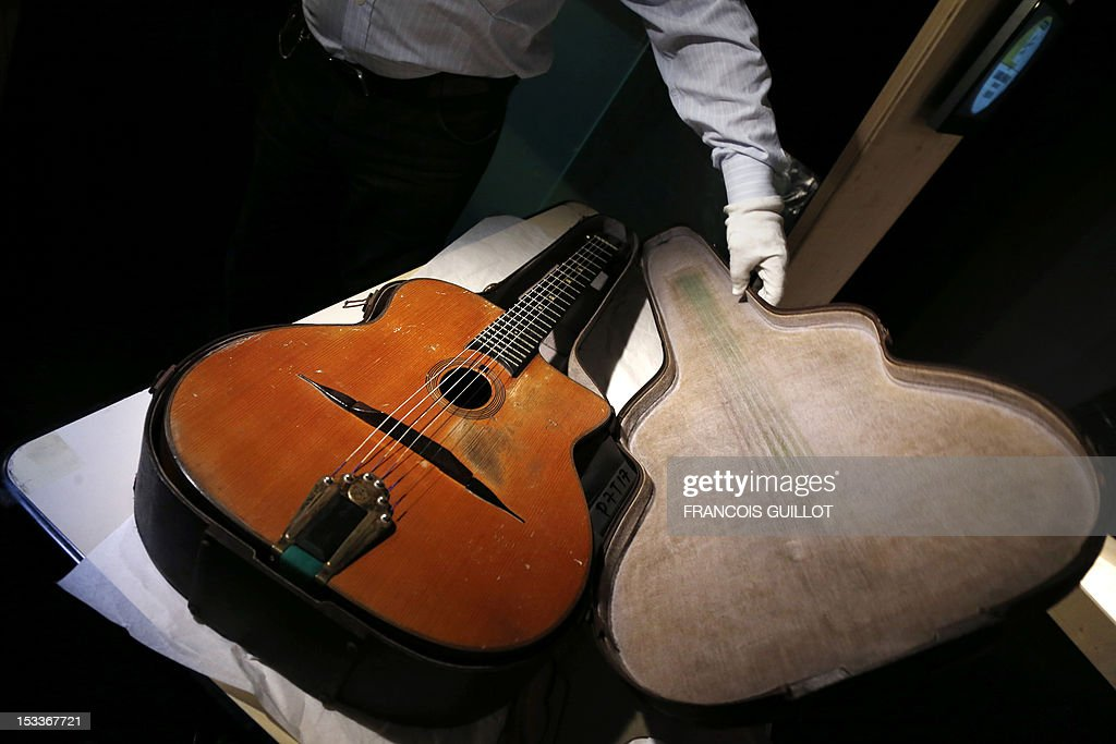 A gipsy jazz guitar made by French guitar maker Selmer for Django Reinhardt is presented during the exhibition entitled 'Django Reinhardt, Paris swing', dedicated to the French jazz guitar player Jean-Baptiste Reinhardt, aka Django, on October 4, 2012 at the Cite de la Musique in Paris. The event runs from October 6 to January 23, 2013. In addition to a collection of unpublished documents and the re-creation of the legendary Selmer guitar workshop, the exhibition gives a place to people who have captured the heart and soul of Paris : photographers, sculptors as well as writers and painters.
