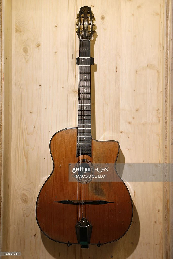 guitar maker It whispers, it sings, it rocks, and it howls it expresses the voice of the folk—the  open road, freedom, protest and rebellion, youth and love it is the acoustic guitar.