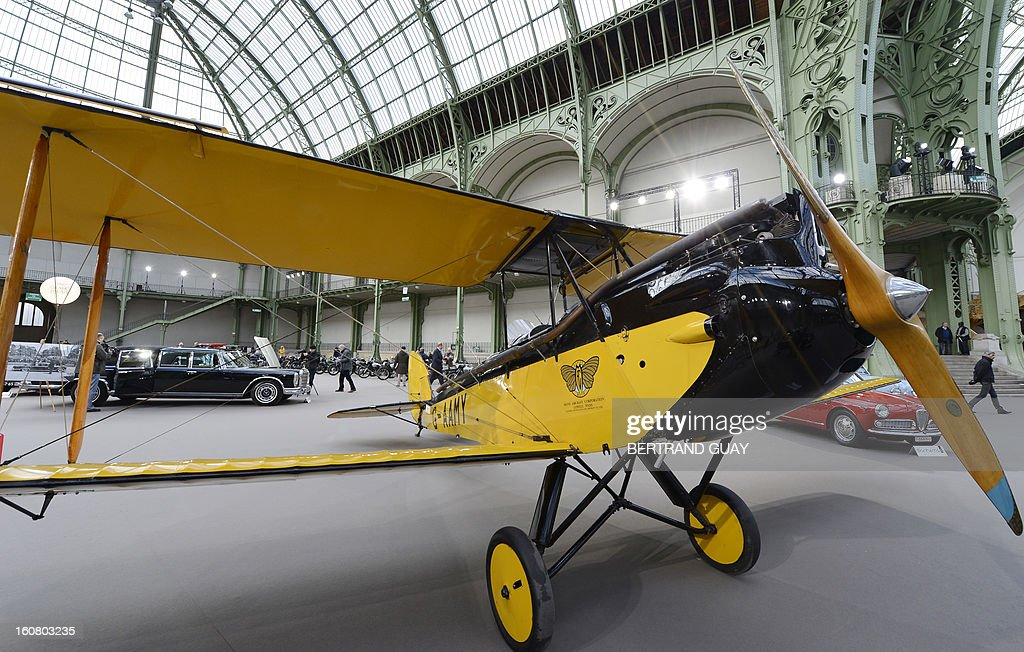 A Gipsy Moth De Havilland plane (1929) featured in the 'Out of Africa' film is pictured as luxury vintages cars are displayed at an auction at the Grand Palais on February 6, 2013 in Paris. 125 vintage motor cars, 100 collection motorbikes and a 1920's Gipsy Moth plane by De Havilland, will be presented at the Bonhams auction on February 7.