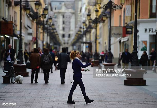 A gipsy woman offers rosemary shoots as she walks in a street of Zaragoza in Aragon region on November 25 2015 Aragon is to Spain like Ohio is to the...