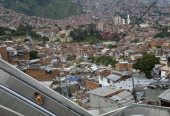 A gir goes up the escalators at Comuna 13 neighborhood in Medellin Antioquia department Colombia on December 26 the day of their inauguration The...