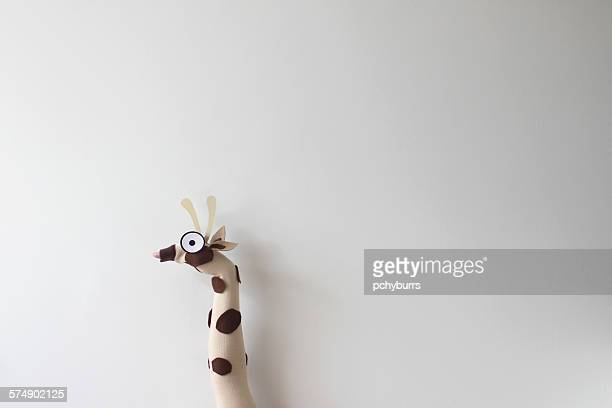 Hand and arm wearing giraffe handcraft puppet