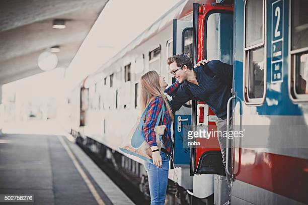 girfriend  clings to a boyfriend  as he  prepares to leave