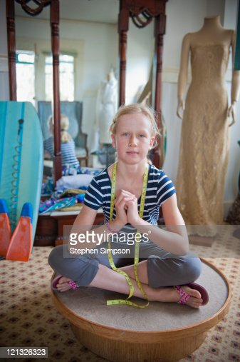 girl [10] and her dressmaking projects : Stock Photo