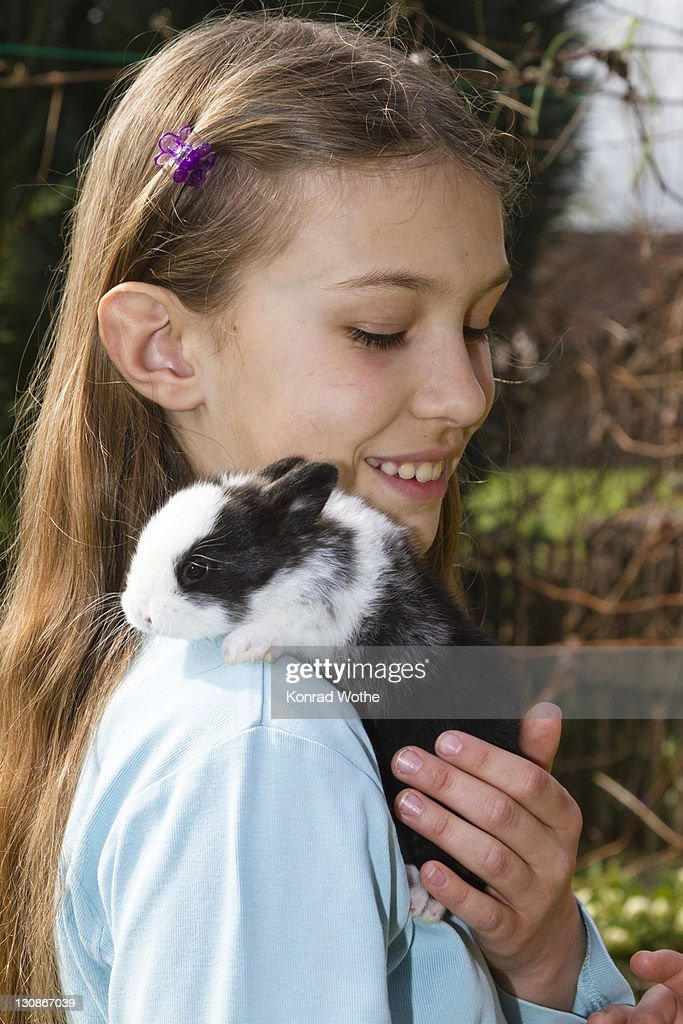 Girl, 10 years old, with pet rabbit : Stock Photo