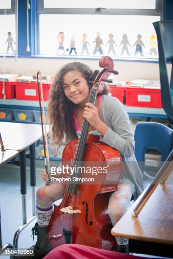 girl [11] practicing cello after school : Stock Photo
