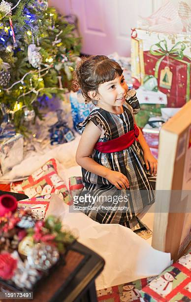 Girl Admires Present in Large Box