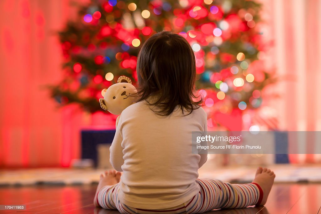 Girl admiring Christmas tree : Stock Photo