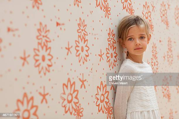 girl against flower wall