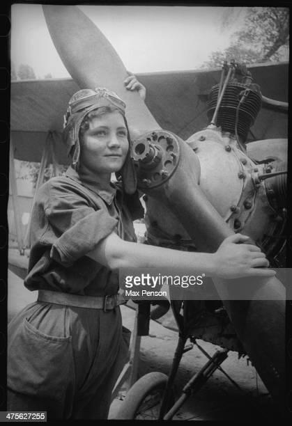 A Girl an aviator at a screw of plane Uzbekistan circa 1940