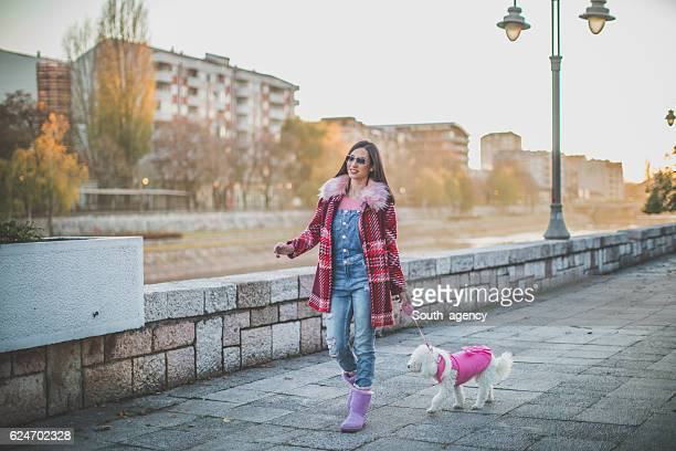 Girl and a dog taking a walk