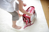 Girl and backpack for school on rug