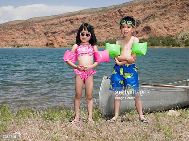 Girl and boy by lake