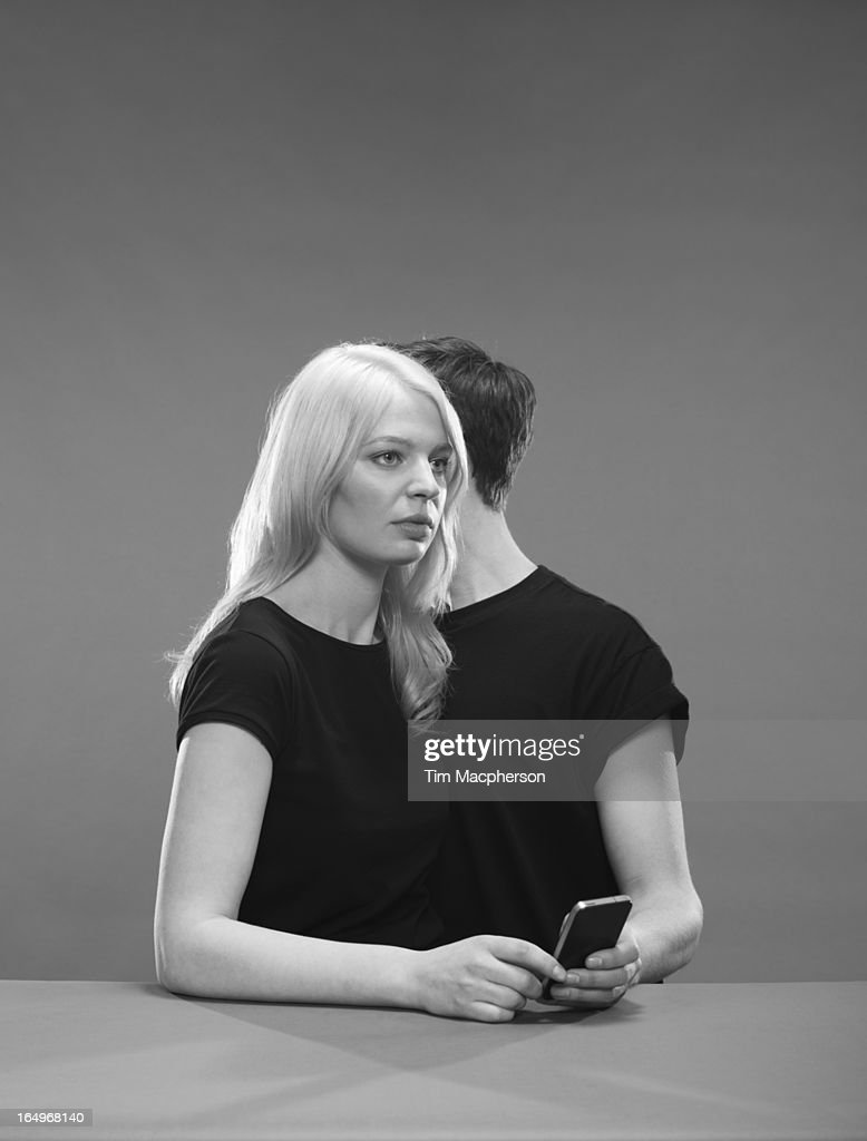 Girl and Boy hold a phone : Stock Photo