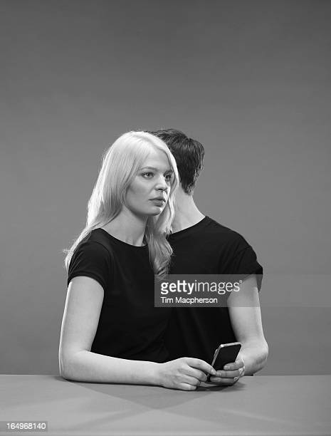 Girl and Boy hold a phone