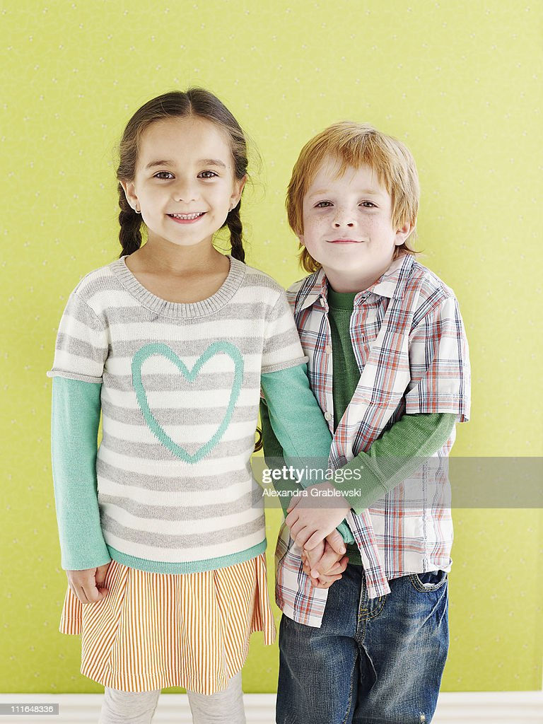 Girl and Boy Holding Hands : Stock Photo