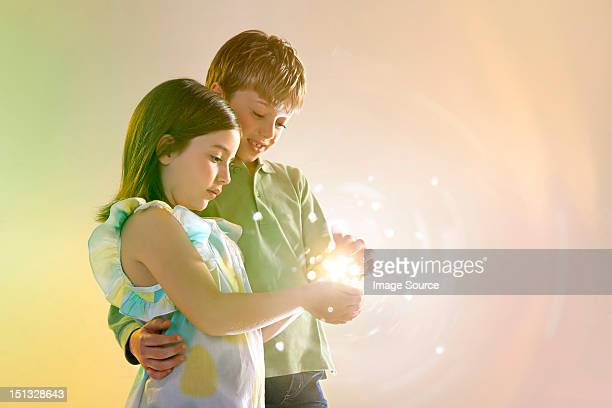Girl and boy holding lights