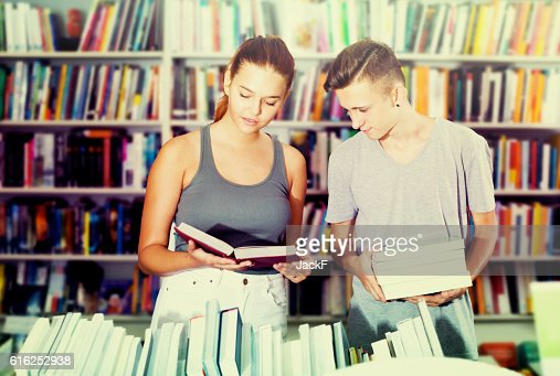 Girl and boy in book store : Stock Photo