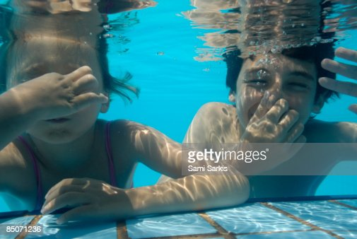 Girl And Boy In Swimming Pool Stock Photo Getty Images