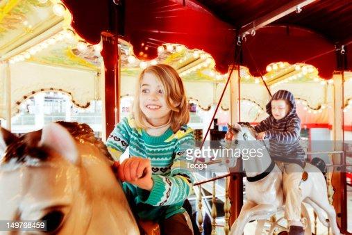 Girl and boy on carousel