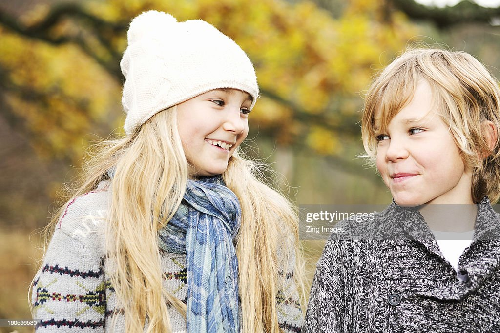 Girl and boy outdoors : Stock Photo