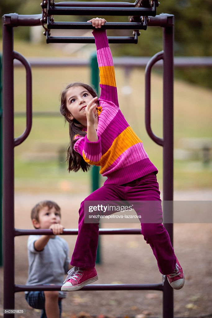 Children (2-3, 6-7) on climbing frame