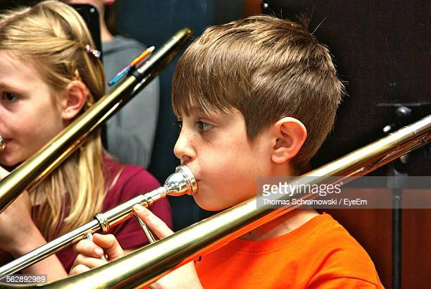 Girl And Boy Playing Trombone