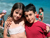 Girl and boy posing together at beach