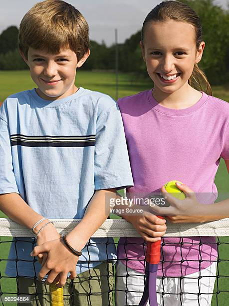 Girl and boy ready for tennis
