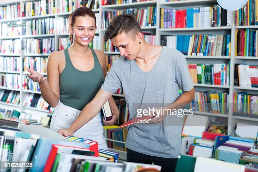 girl and boy teenagers in book store : Stock Photo