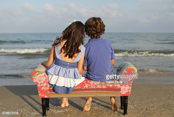 Girl and boy together at beach