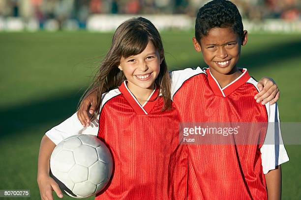 Girl and Boy With Soccer Ball
