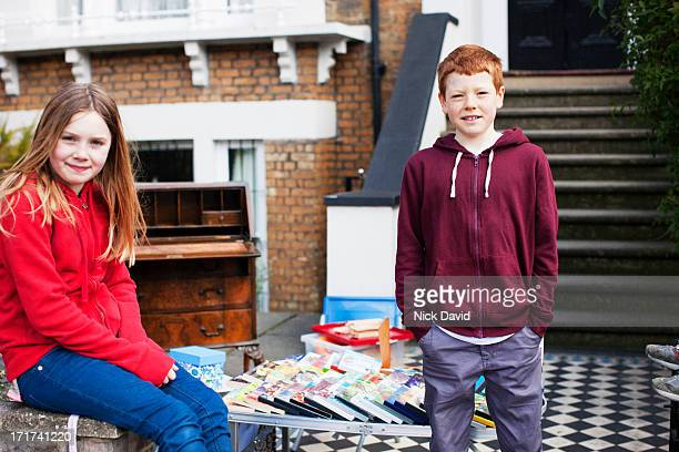 girl and boy with yard sale