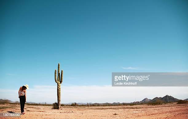 Girl and cactus in Arizona desert