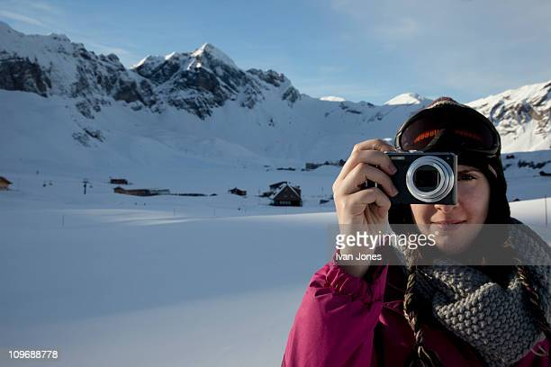 girl and camera in snowy landscape