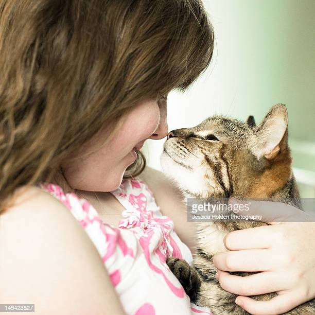 Girl and Cat Kissing