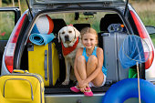 Vacation, Travel - girl with dog ready for the travel for summer vacation