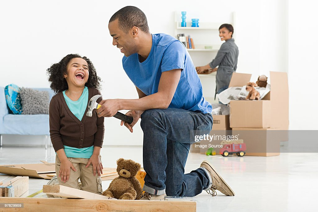 Girl and father building furniture : Stock Photo