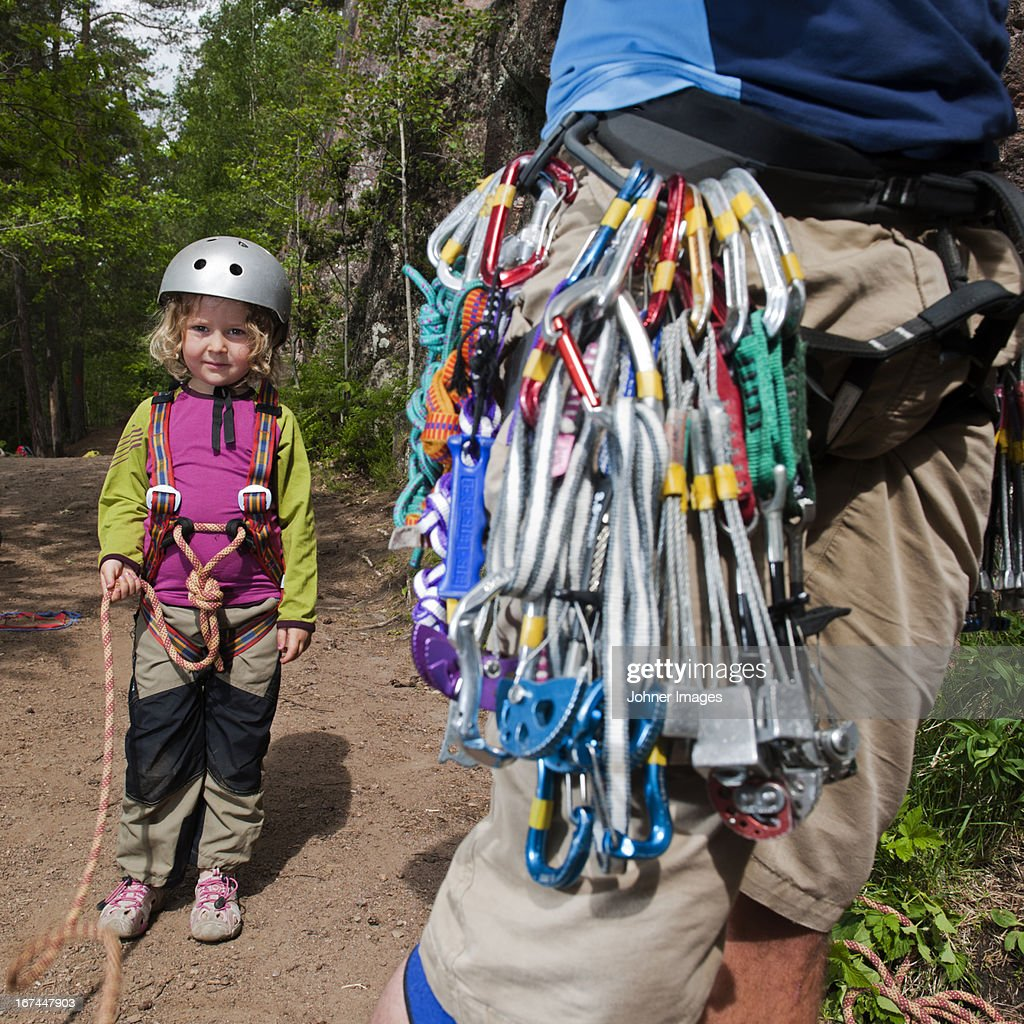 Girl and father equipped before climbing : Stock Photo