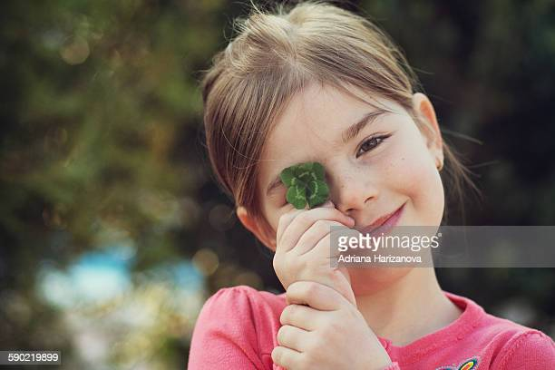 Girl and Four Leaf Clover